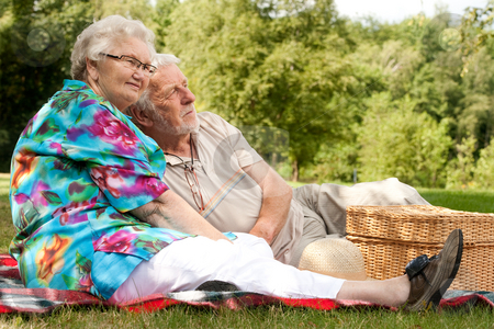 Elderly couple enjoying the spring stock photo, Elderly couple enjoying the spring in the park by Frenk and Danielle Kaufmann