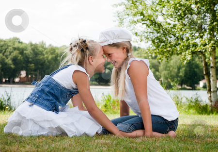 Head hugs in the grass stock photo, Two little girls in fresh colors in the park by Frenk and Danielle Kaufmann