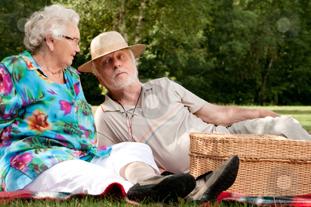Grandfather with a hat stock photo, Elderly couple enjoying the spring in the park by Frenk and Danielle Kaufmann