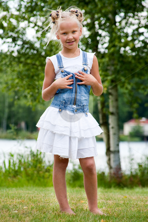 Sweet little jeansgirl stock photo, Sweet little girl in jeans on the grass by Frenk and Danielle Kaufmann