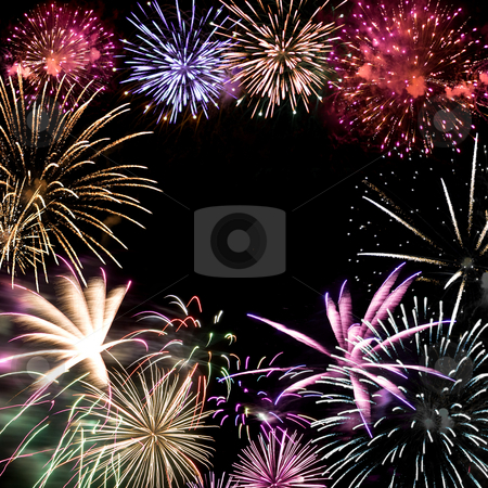 Fireworks Grand Finale stock photo, Beautiful fireworks exploding over a dark night sky with copy space in the center. by Todd Arena