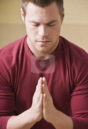 Attractive male in prayer stock photo, Attractive male praying with eyes closed and palms together. Vertical by Jonathan Ross