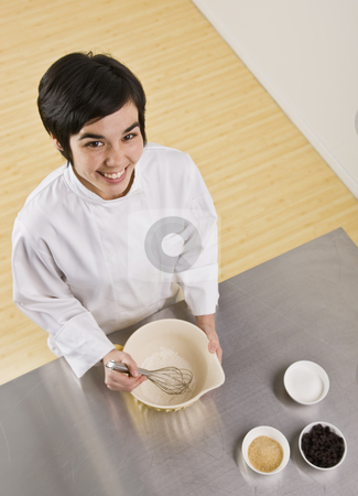 Attractive woman with whisk. stock photo, Attractive brunette woman with whisk and bowl, smiling at camera. Vertical by Jonathan Ross
