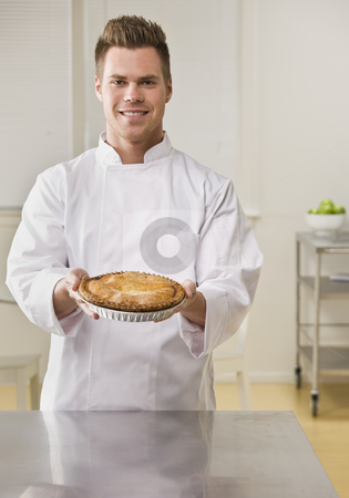Attractive male with pie. stock photo, Attractive brunette male holding pie and smiling at camera. Vertical. by Jonathan Ross
