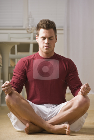 Attractive male in lotus position. stock photo, Attractive male in lotus position with eyes closed and hands on knees. Vertical by Jonathan Ross