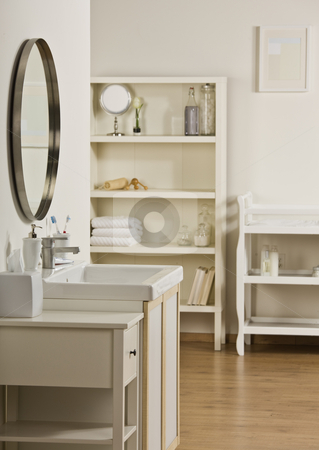 Bathroom sink and mirror stock photo, Room with sink, mirror, shelving and cabinets. All white. Vertical by Jonathan Ross