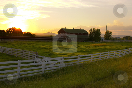 Countryside Fence Leading to A Ranch stock photo, Wooden Fence by the Countryside Ranch During Sunset by Mehmet Dilsiz