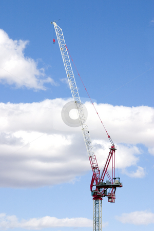 Construction Site Crane with Clouds on the Background stock photo, Construction Site Crane by Mehmet Dilsiz