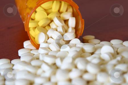 Bottle of Medicine stock photo, Bottle full of medicine by Mehmet Dilsiz