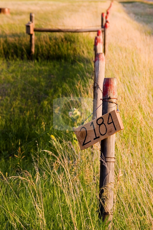 Countryside Fence with Street Number Sign stock photo, Wooden Fence by the Countryside with the street number sign by Mehmet Dilsiz