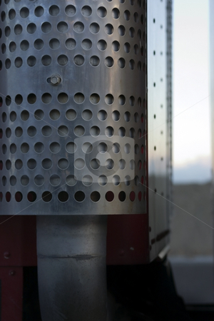 Close up on a Semi Pipe stock photo, Close up on a patterned pipe on a semi truck by Mehmet Dilsiz