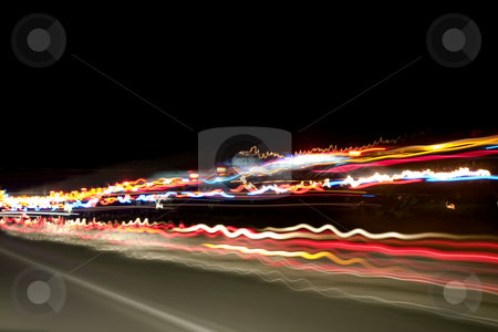 Night Lights on the Highway stock photo, Shot of the highway and car lights taken from the car with a tripod while travelling. by Mehmet Dilsiz