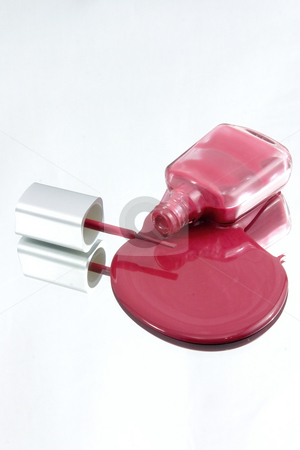 Nail Polish Spilling on a Mirror with the Brush  stock photo, Isolated Nail Polish Spilling on a Mirror with the Brush by Mehmet Dilsiz