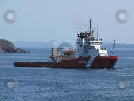 Coast Guard Boat stock photo, Coast Guard Boat speeding over the water by CHERYL LAFOND