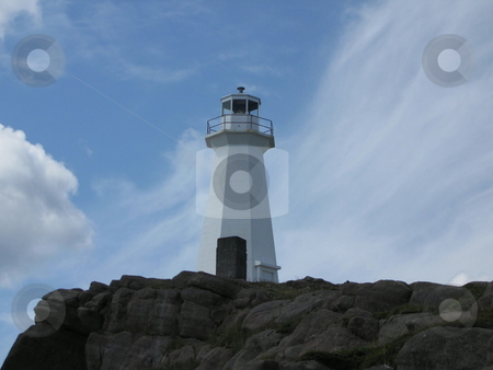 Light House In The Clouds stock photo, A light house sitting in the clouds in harbor grace newfoundland by CHERYL LAFOND