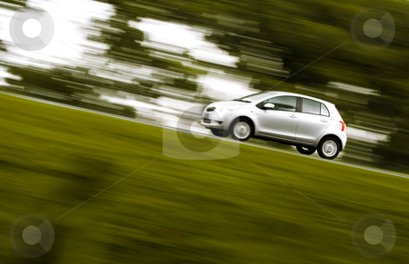 Speedy car rushing away stock photo, Silver car rushing away on a countryside road by R. Eko Bintoro