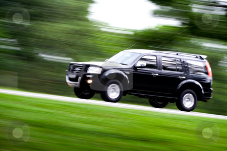 Go on a vacation stock photo, A black suv rushing away on a countryside road going for a vacation by R. Eko Bintoro