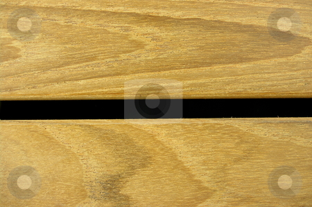 Raw Teak stock photo, Raw teak wood strips. Contrasting against a black background by Martin Darley