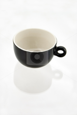 Essential cup of coffee stock photo, Essential photo of an empty black and white cup for coffee with shadow reflection by Roberto Marinello