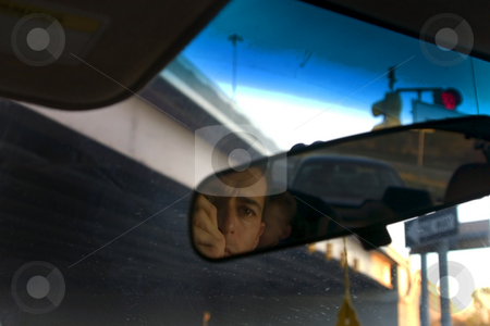 Father & Son in the Car stock photo, Father and Son - Rear View Mirror by Mehmet Dilsiz