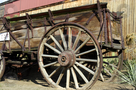 Old Antique Wagon stock photo, Close up on an Old Antique Wagon Wheel by Mehmet Dilsiz