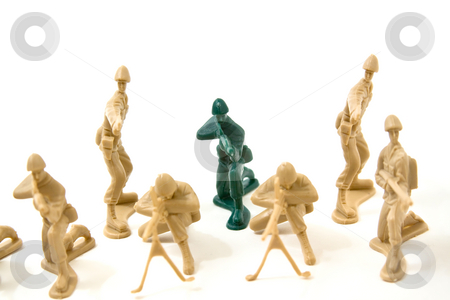 To Be Different Concept - Plastic Army Men stock photo, Isolated Plastic Toy Soldiers - Dare to be Different Concept by Mehmet Dilsiz