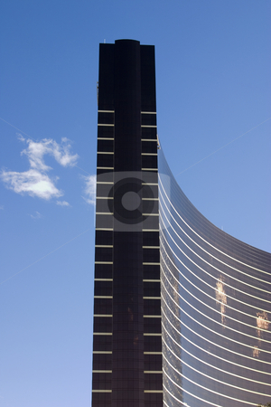 Close up on a modern skyscraper with clear skies stock photo, Close up on a modern skyscraper with clear skies in Las Vegas by Mehmet Dilsiz