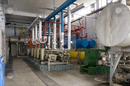 Industrial Generators stock photo, Industrial size generators in a factory machinery room by Mehmet Dilsiz