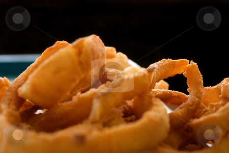 Close up on Onion Rings with Black Background stock photo, Close up shot of Onion Rings with Black Background by Mehmet Dilsiz