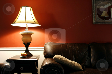 Lamp and the Couch stock photo, Close up on a Lamp and the Coush in a House by Mehmet Dilsiz
