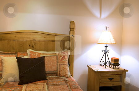 Close up on a bed in a bedroom stock photo, Close up on a bed in a bedroom by Mehmet Dilsiz