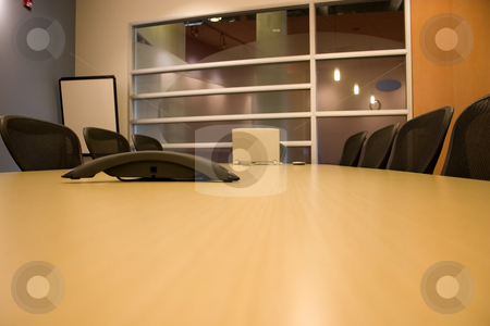 Conference Room stock photo, Conference Room with the empty chairs and a Laptop with a PDA by Mehmet Dilsiz