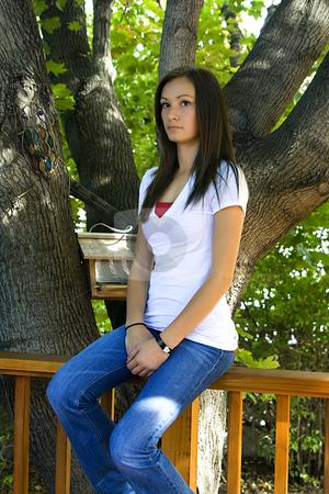 Teenager Girl posing in the Backyard stock photo, Teenager Girl posing under the Tree by Mehmet Dilsiz
