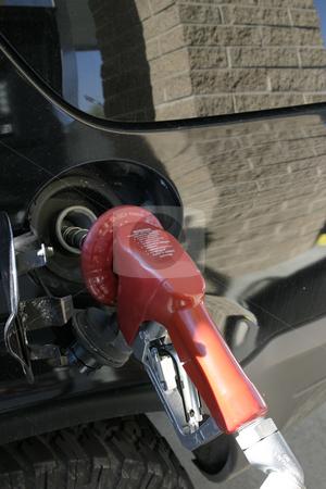 Vertical - Gas Pump Nozzle stock photo, Close up on a Gas Pump Nozzle - Vertical by Mehmet Dilsiz