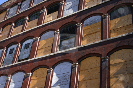 Old Building stock photo, Old Building Windows with Woden Boards covering them by Mehmet Dilsiz