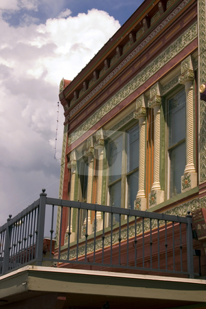 Close up on an Old Building with Cloudy Background stock photo, Old Colonial Building by Mehmet Dilsiz