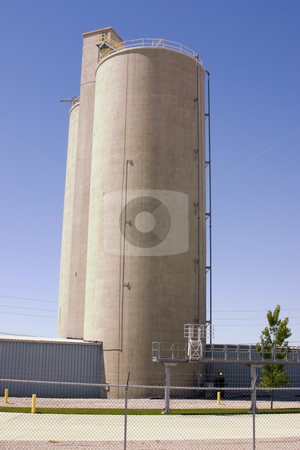 Sile behind Fences stock photo, Silo behind fences with clear blue skies by Mehmet Dilsiz