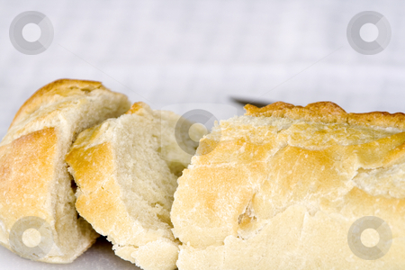 Close up on a Sliced Bread stock photo, Close up on a Sliced Bread on a Table by Mehmet Dilsiz
