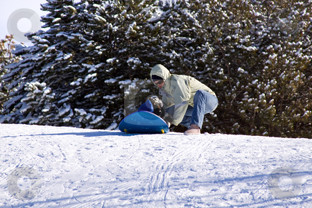 Mother and Son Sledding down the Hill stock photo, Mother and Son Sledding  - Winter Scenes by Mehmet Dilsiz