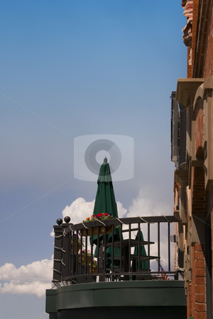 Balcony of a Bar in a Building stock photo, Balcony of a Bar in a Building with Blue Skies by Mehmet Dilsiz