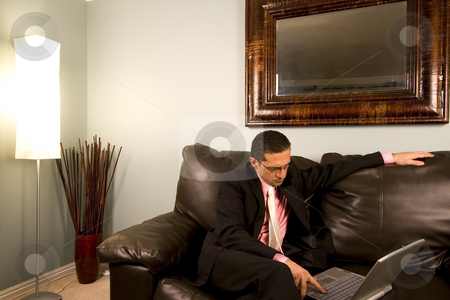 Home or Office - Businessman Working on the Couch stock photo, Home or Office - Businessman with his Glasses working on the Couch by Mehmet Dilsiz