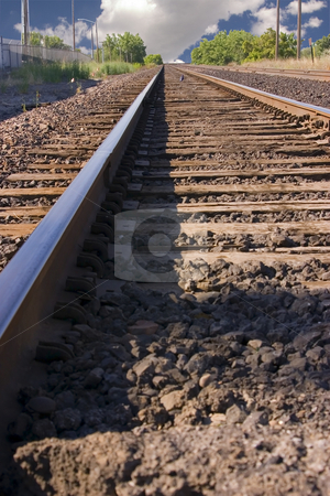 Railroad Tracks with Clouds in the Horizon stock photo, Close up on Railroad Tracks with the Cloudy Horizon by Mehmet Dilsiz