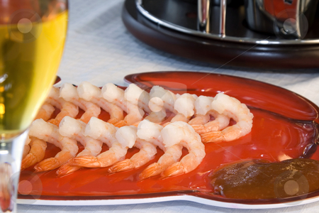 Shrimps on a Plate with a Blurred Wine Glass in the foreground stock photo, Close up - Shrimps on a Plate with a Blurred Wine Glass in the Foreground by Mehmet Dilsiz
