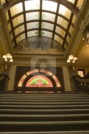 Stairway to Stained Glass in the Capital Building - Vertical Sho stock photo, Vertical Shot of Stairways to the Second Floor of the Capital Building in Helena Montana by Mehmet Dilsiz