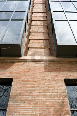 Looking up stock photo, Close up on a Building from Bottom to Top by Mehmet Dilsiz