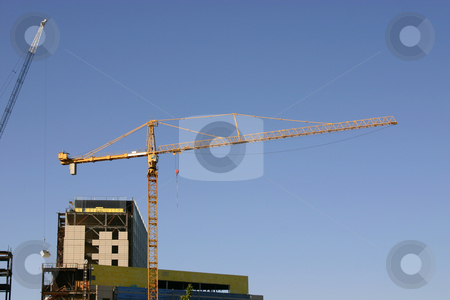 Construction site & the Crane stock photo, Construction site- Zoomed in by Mehmet Dilsiz