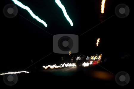 Night Lights stock photo, Shot of street and car lights taken from the car with a tripod while travelling. by Mehmet Dilsiz