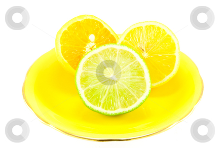 Citrus Halves on a Yellow Plate stock photo, Lemon, lime and orange half on a fancy yellow plate on a white background by Keith Wilson