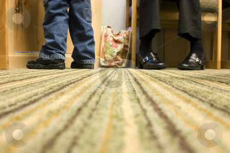 Floor Level Shot of Mom and Son at a Doctor's office stock photo, Floor Level Shot of Mom and Son - shoes and feet on the carpet by Mehmet Dilsiz