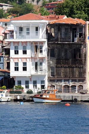 Old and New Houses in Istanbul stock photo, Old and New Houses by the Water in Istanbul by Mehmet Dilsiz